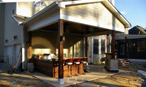 outdoor porch with bar grill and fireplace home addition ideas