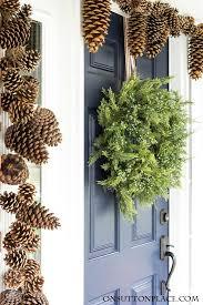 christmas front door decor juniper u0026 pinecones on sutton place