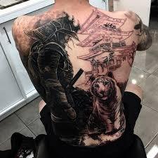 black ink samurai with tiger on back