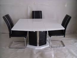 modern white gloss dining table extending central part white dining table and 4 chairs modern