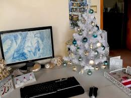 tiny christmas tree on desk doing all for office worker u0027s