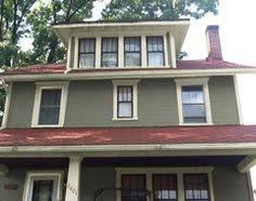 dark green house red roof google search house ideas
