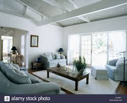 white living room in barbados with pale blue sofa and chairs and