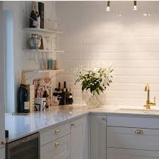 Backsplash With White Kitchen Cabinets by Bathroom White Tile Backsplash With Ceiling Lights And White