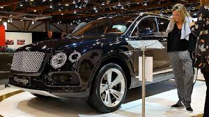 black bentley black bentley bentayga luxury suv car front view two women are