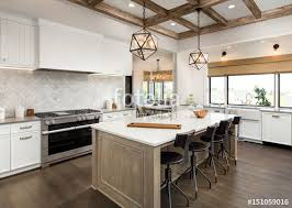 beautiful kitchen in luxury home with island cross hatch wood