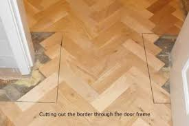 oak herringbone parquet with rhodesian teak parquet border