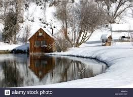 small cabin on a pond in the mountains of utah stock photo