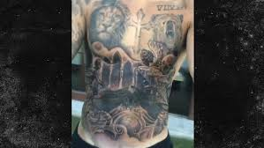 justin bieber shows off torso now entirely covered in tattoos
