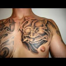 japanese mask and star tattoo designs on chest real photo