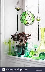 green ornaments on a windowsill sweden stock photo 23610202 alamy