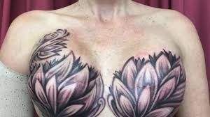 breast cancer survivors reclaim their bodies with tattoos over scars