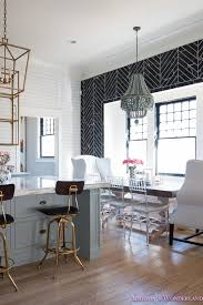 breakfast room black chevron wall tile white wingback dining