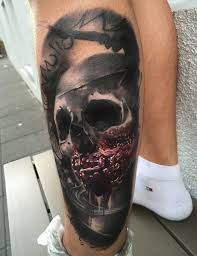 zombie skull tattoo on left leg by maksims zotovs