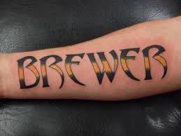 last name tattoos on arm design for
