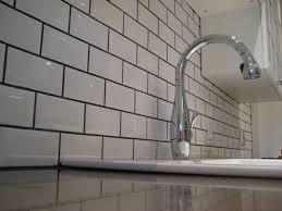 white tile kitchen floor white subway tile backsplash with dark