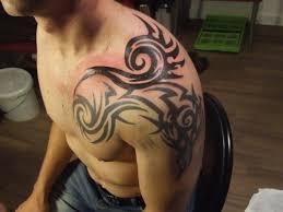 tribal women tattoo on shoulder