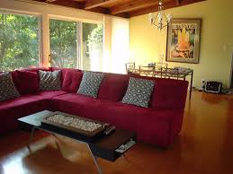 red couch with yellow walls with a cedar ceiling for the home