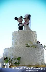 mickey and minnie cake topper disney wedding cake with swirl design and a mickey and minnie cake