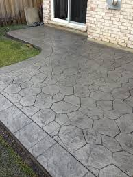 Stamped Concrete Backyard Ideas by Random Stone Stamped Concrete Patio With Stone Block Border In
