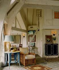 corner of french normandy barn and great room designed by thomas