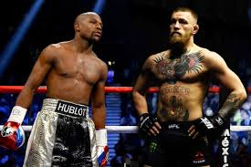 boxer dog in boxing gloves mayweather explains that mcgregor is live dog in their fight
