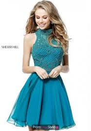 green dresses at prom dress shop