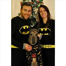 mosley the greyhound plays in the snow in his batman pajamas