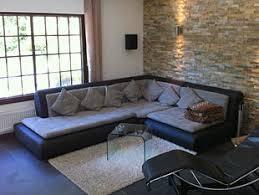 steinwand wohnzimmer mietwohnung wände im naturstein look zimmerschau