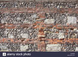 flint and brick walls winchester hampshire england stock photo