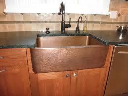 contemporary copper farmhouse sink in white kitchen and
