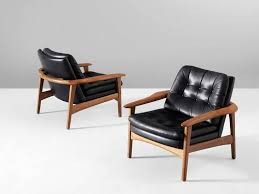 scandinavian armchair pair of scandinavian armchairs in teak and black leather at 1stdibs