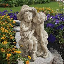 boy and statue for garden sitting kissing playing and reading