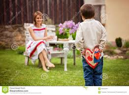 beautiful mom having coffee in a backyard young cute child giv