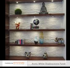 stone wall with shelves condo living pinterest stone walls stone wall with shelves fireplace