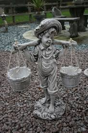 boy and statues garden ornaments berkshire