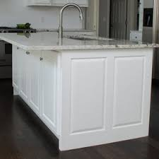 custom kitchen island acid stained and exposed rock to resemble a