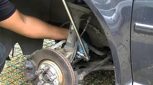 vw front shock absorber removal youtube
