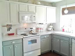 kitchen decorating with white appliances and mint green cabinets