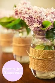 jar floral centerpieces burlap covered jar centerpieces budget brides guide a