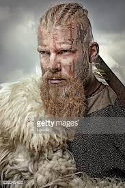 viking warrior hair close up of individual viking warrior in emotional pose stock