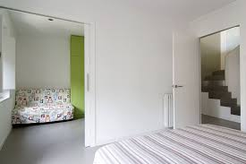 Bedroom Ideas Bed In Corner Nice Looking White Basement Bedroom Design With Stripped Bed Sheet