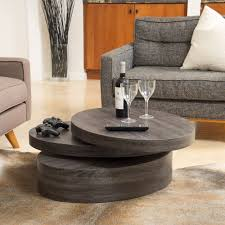 the carson oval mod rotating wood coffee table offers a clear late