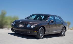bentley continental flying spur 2013 cadillac xts vs 2012 bentley continental flying spur speed
