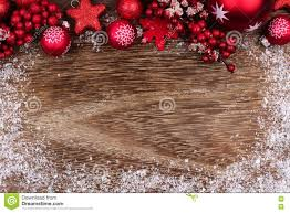 red christmas ornament top border with snow frame on wood stock