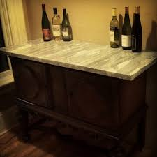 kitchen island out of old buffet and slab of granite repurposed