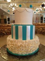 elegant green and pink wedding cake in buttercream green scroll