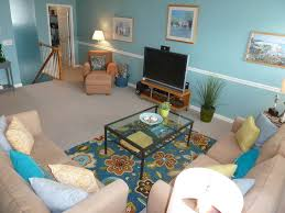 tropical living room with chair rail u0026 carpet in rehoboth beach