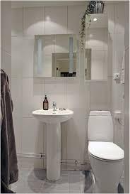 apartment bathroom ideas stainless steel pull handle beige ceramic floor tiled small