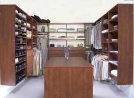 Small Walk In Closet Design Idea With Shoe Storage Shelving Unit Dark Brown Wooden Closet With Many Shelves Combined With White
